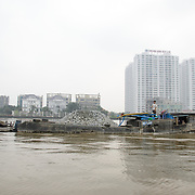 A boat transports broken up concrete along the Saigon River in Ho Chi Minh City, Vietnam.