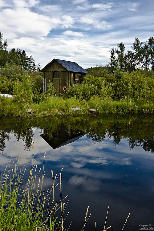 Peaceful summer afternoon at the fishing pond in rural Alberta, Canada.