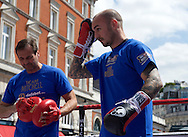 Kevin Mitchell and Trainer Tony Sims during a public workout in Covent Garden, London<br /> Picture by Alan Stanford/Focus Images Ltd +44 7915 056117<br /> 26/05/2015