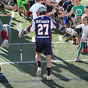 Kevin Buchanan #27 of the Boston Cannons runs onto the field prior to the game at Harvard Stadium on May 17, 2014 in Boston, Massachuttes. (Photo by Elan Kawesch)