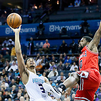 03 November 2015: Charlotte Hornets guard Jeremy Lamb (3) takes a jump shot over Chicago Bulls guard Aaron Brooks (0) during the Charlotte Hornets  130-105 victory over the Chicago Bulls, at the Time Warner Cable Arena, in Charlotte, North Carolina, USA.