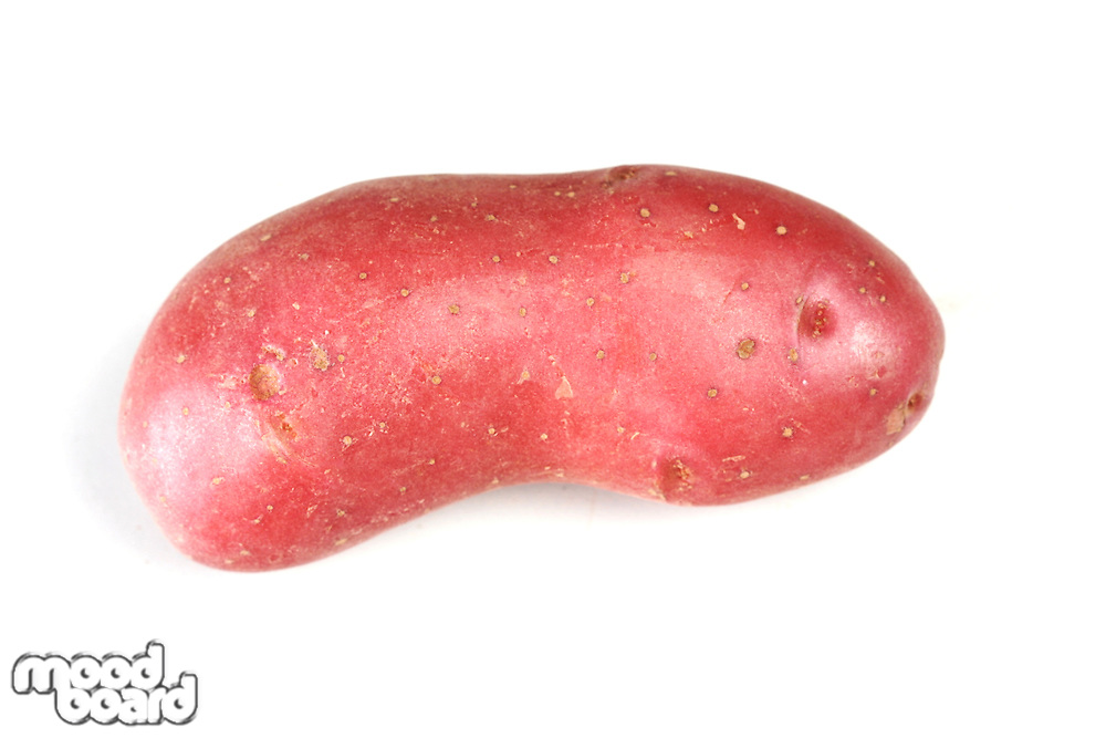 Red potato on white background