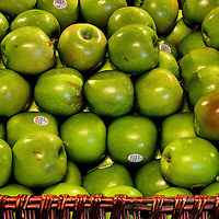 Green Granny Smith Apples in Basket at Farmers Market in Vancouver, Canada