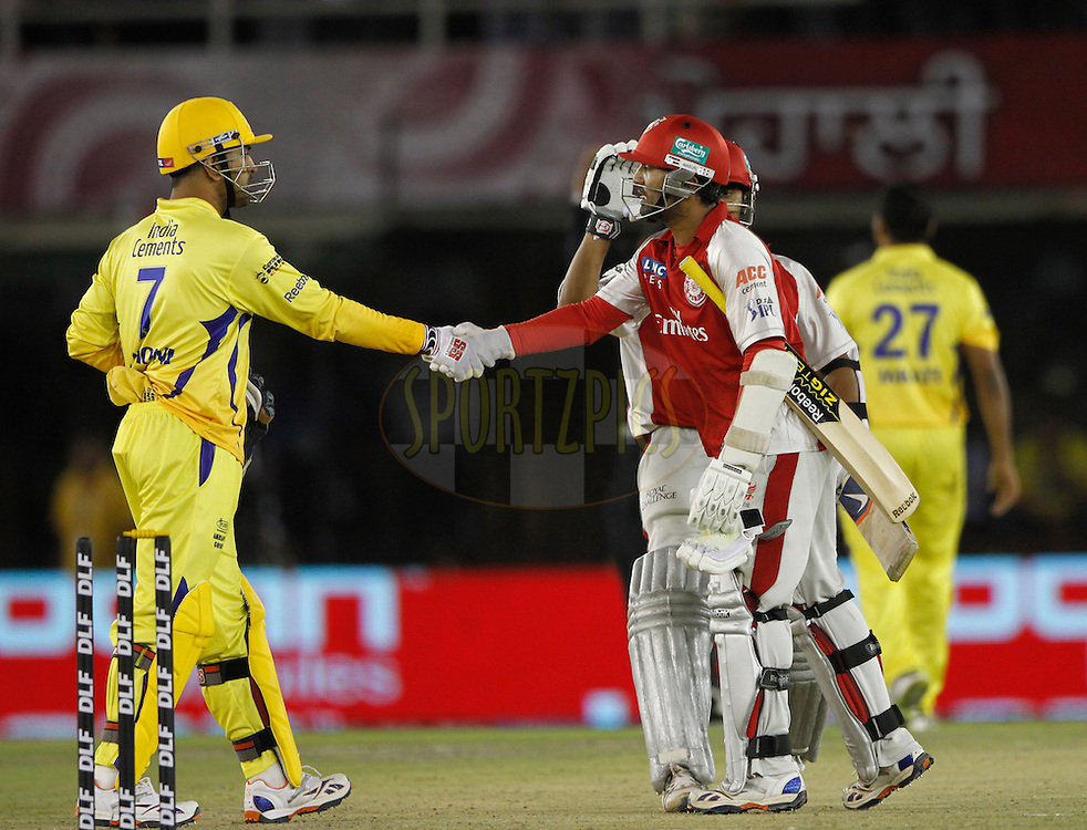 Kings XI Punjab Dinesh Karthik hand- shaks with Chennai Super King captain MS Dhoni after the win the match 9 of the Indian Premier League ( IPL ) Season 4 between the Kings XI Punjab and the Chennai Super Kings held at the PCA stadium in Mohali, Chandigarh, India on the 13th April 2011..Photo by Pankaj Nangia/BCCI/SPORTZPICS