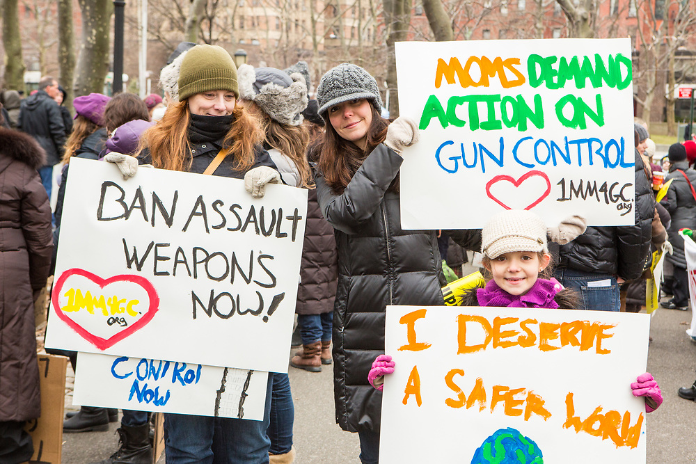 Marchers display their placards at the Brooklyn end of the bridge. The March was sponsored by One Million Moms for Gun Control.