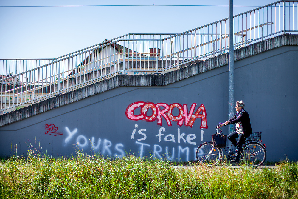 "Graffiti sprayed on a wall at the Oberursel-Stierstadt S-Bahn station reads: 'Corona is Fake'. and somebody added later ""Yours Trump""."