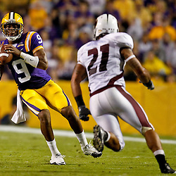 November 13, 2010; Baton Rouge, LA, USA; LSU Tigers quarterback Jordan Jefferson (9) is pressured by Louisiana Monroe Warhawks cornerback Vincent Eddie (27) during the first half at Tiger Stadium.  Mandatory Credit: Derick E. Hingle