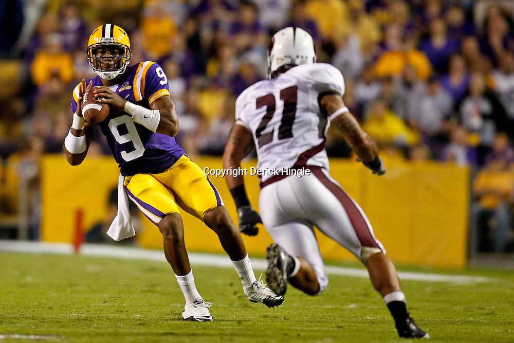 November 13, 2010; Baton Rouge, LA, USA; LSU Tigers quarterback Jordan Jefferson (9) is pressured by Louisiana Monroe Warhawks cornerback Vincent Eddie (27) during the first half at Tiger Stadium.  Mandatory Credit: Derick E. Hingle