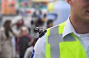 Nederland, NIjmegen, 18-7-2012Een politieman loopt met een schoudercamera, een kleine videocamera die een directe verbinding heeft met de controlekamer.Foto: Flip Franssen/Hollandse Hoogte