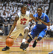 """Mississippi's Jarvis Summers (32) drives against Kentucky's Ryan Harrow (12) at the C.M. """"Tad"""" Smith Coliseum on Tuesday, January 29, 2013.  (AP Photo/Oxford Eagle, Bruce Newman).."""