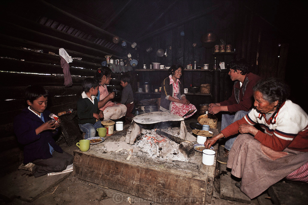A family eats a meal on a wood fire in their ranch kitchen near the Monarch butterfly reserve. Site Alpha, near Rosario, Mexico.