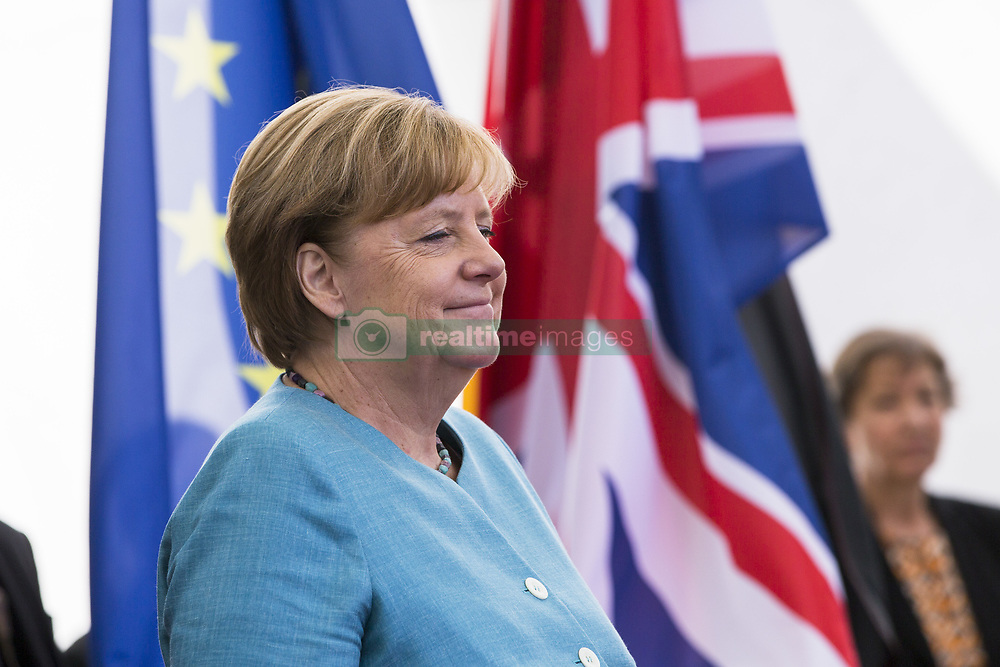 July 19, 2017 - Berlin, Germany - German Chancellor Angela Merkel awaits for the arrival of Britain's Prince William, Duke of Cambridge and his wife Kate, the Duchess of Cambridge at the Chancellery in Berlin on July 19, 2017. (Credit Image: © Emmanuele Contini/NurPhoto via ZUMA Press)