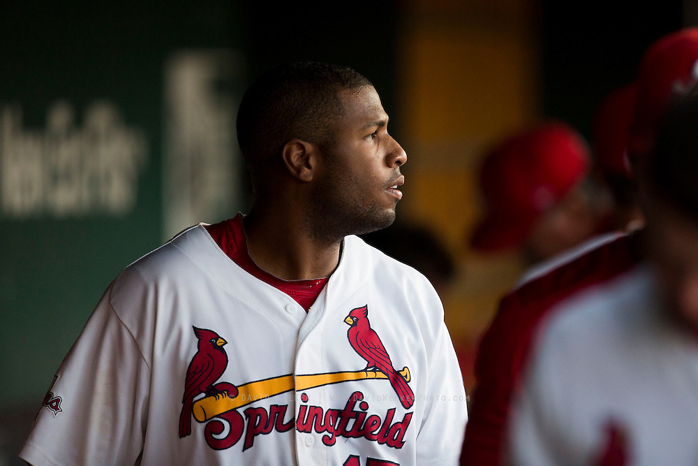 Xavier Scruggs (15) of the Springfield Cardinals looks out towards the field from the dugout during a game against the Northwest Arkansas Naturals at Hammons Field on August 20, 2013 in Springfield, Missouri. (David Welker)