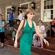 "Best-selling author Nora Roberts is surrounded by fans outtside the Inn at Boonsboro, as she walks to a book-signing lunch in historic Boonsboro, Maryland. Ms. Roberts bought the 1790s-era building and created an eight-room boutique hotel meant to cater to women's romantic sides...Rooms are named for famous literary couples, including Marguerite and Percy of ""The Scarlet Pimpernel"" and Jane and Rochester from ""Jane Eyre."" Ms. Roberts spent $3 million renovating the three-story inn."