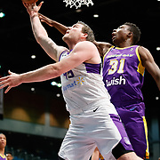 Reno Bighorns Center JACK COOLEY (45) shoots against South Bay Lakers Center THOMAS BRYANT (31) during the Western Conference Semi-Final NBA G-League Basketball game between the Reno Bighorns and the South Bay Lakers at the Reno Events Center in Reno, Nevada.