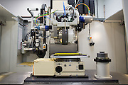 A Magneto-Rheological Finishing machine, used to finish high quality optics, at Exelis Inc. in Rochester, New York on September 10, 2014. Exelis is an aerospace and defense company, and employs numerous former Kodak workers in its Rochester facility.