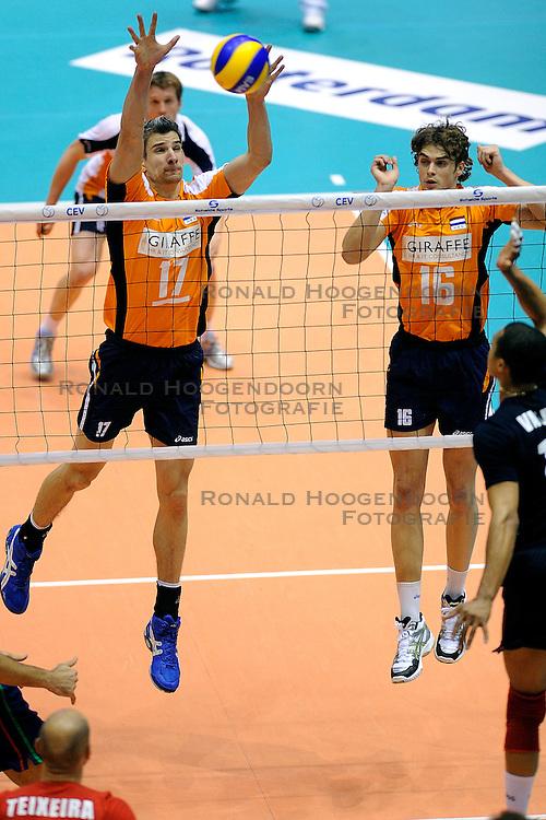 30-05-2010 VOLLEYBAL: EK KWALIFICATIE NEDERLAND - PORTUGAL: ROTTERDAM <br /> Nederland verslaat Portugal met 3-0 / Rob Bontje en Dick Kooy<br /> &copy;2010-WWW.FOTOHOOGENDOORN.NL