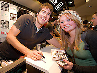 HMV welcomed The Coronas to HMV Galway  for a live performance and to sign copies of their nhighly anticipated third album Closer To You. Dave McPhilips from the band had a big hug for Shona Dawson from Headford.  Photo:Andrew Downes.