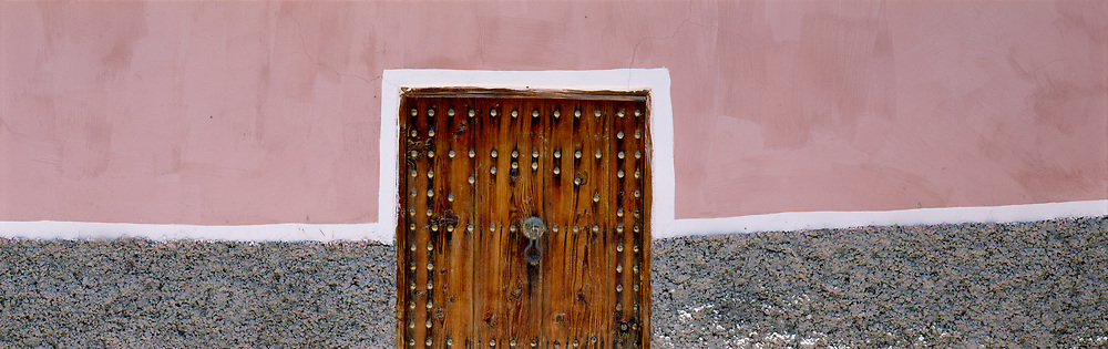 Wall with doorway, pink and white line