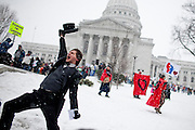 S. Montgomery Priz lampoons the rich outside the  Wisconsin State Capitol over a bill that threatens to strip collective bargaining rights in Madison, Wisconsin, February 26, 2011. Crowds swelled Saturday as protests enter their 12th day.