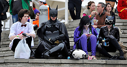 © Licensed to London News Pictures. 30/10/2011. London, UK. A man dressed as Batman sits with a group of friends. The London Comic Con today, 30th October 2011 as fans of comics, computer games and Sci-Fi movies,  dress up as some of their favourite characters. The London MCM Expo takes place on 28-30th October 2011 at the excel centre in London.  Photo: Stephen Simpson/LNP