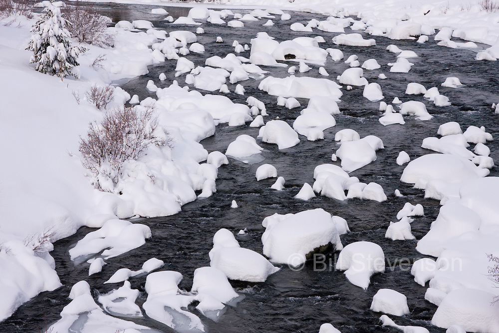 A photo of the Truckee River on a snowy day in California