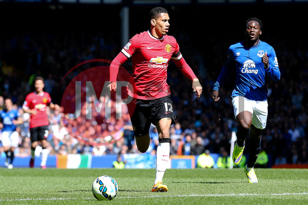Chris Smalling of Manchester United is chased by Everton's Romelu Lukaku   - Photo mandatory by-line: Matt McNulty/JMP - Mobile: 07966 386802 - 26/04/2015 - SPORT - Football - Liverpool - Goodison Park - Everton v Manchester United - Barclays Premier League