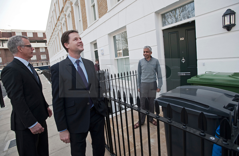 © London News Pictures. 23/03/2012. London, UK.  Liberal Democrat Leader Nick Clegg (centre) and London Liberal Democrat mayoral candidate Brian Paddick (left) speaking to Islington resident  Eqbal Hussain Chowdhury (right) on his doorstep during a walk around Islington, London on March 23, 2012. The Liberal Democrats  have worked with the police in the local area to reduce crime. Photo credit: Ben Cawthra/LNP
