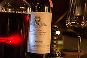 New York, NY, Sept. 30, 2013. Grant Reynolds, wine director at Charlie Bird. A bottle of Barolo which has been decanted.