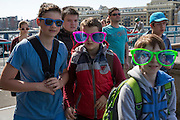 A group of young male students on a tourist trip across Tower bridge wearing oversized sunglasses. Tower Bridge, London. 5th May 2016 (photo by Andrew Aitchison / In pictures via Getty Images)