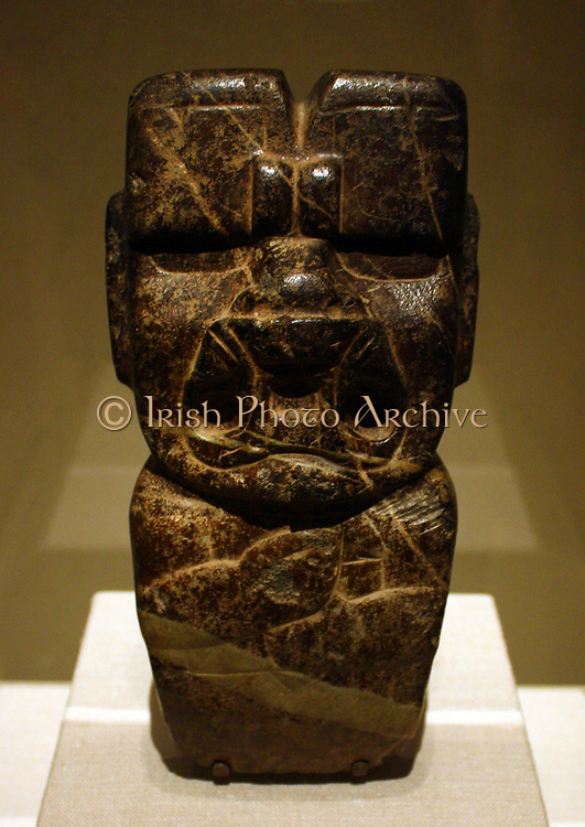 Olmec Mask.  Mexico, Olmec.  10th-6th century B C.  Jade (jadeite).  This mask, with its harmonious proportions and smooth, highly polished planes of cheek, forehead and chin has an almost fleshy quality of nose and lips that belies the incredible hardness.