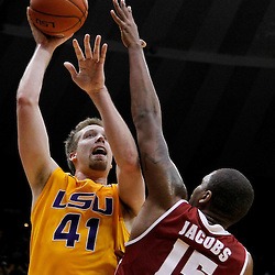 February 11, 2012; Baton Rouge, LA; LSU Tigers center Justin Hamilton (41) shoots over Alabama Crimson Tide forward Nick Jacobs (15) during the second half of a game at the Pete Maravich Assembly Center. LSU defeated Alabama 67-58.  Mandatory Credit: Derick E. Hingle-US PRESSWIRE