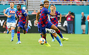 FC Barcelona defender Jean-Clair Tobido (6) races to a loose ball with SSC Napoli forward Lorenzo Insigne (24) during a La Liga-Serie A Cup soccer match, Wednesday, Aug. 7, 2019, in Miami Gardens, Fla. FC Barcelona beat Napoli 2-1 (Kim Hukari/Image of Sport)