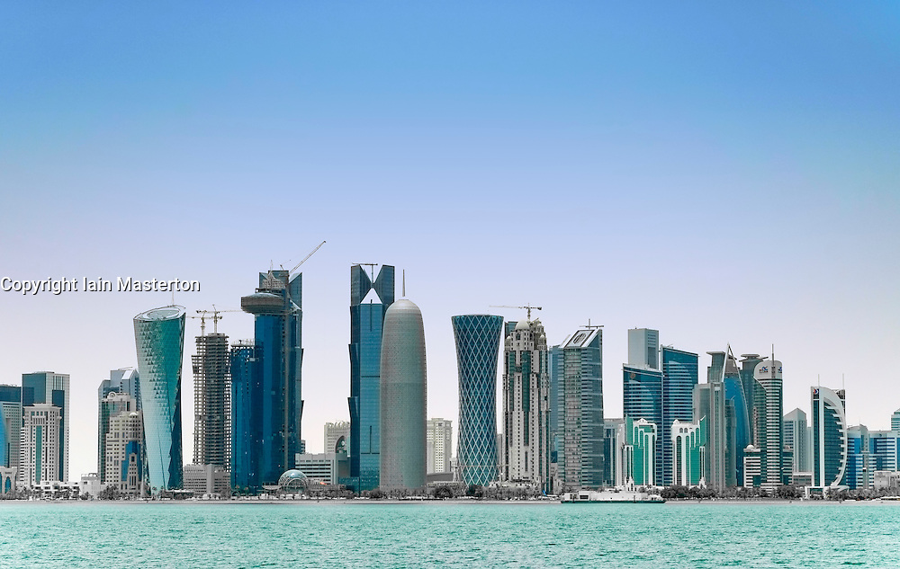 view of many skyscrapers in business district of West Bay along Corniche in Doha Qatar