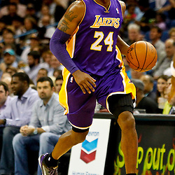 Dec 5, 2012; New Orleans, LA, USA; Los Angeles Lakers shooting guard Kobe Bryant (24) drives down the court against the New Orleans Hornets during the first quarter of a game at the New Orleans Arena.  Mandatory Credit: Derick E. Hingle-USA TODAY Sports