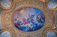 Centerpiece of colourful ceiling frieze at the Louvre, Paris