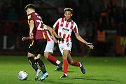Connor Wood and Dan Bowry  during the EFL Sky Bet League 2 match between Cheltenham Town and Bradford City at Jonny Rocks Stadium, Cheltenham, England on 17 September 2019.