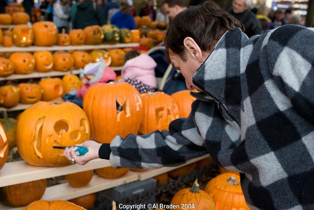 Lighting Jack o Lanterns at Keene Pumpkin Festival