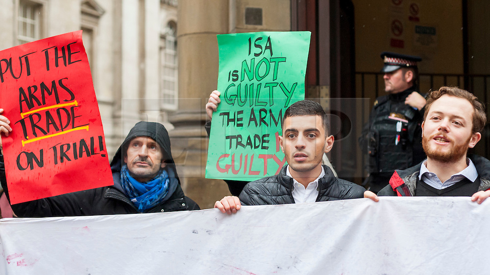 © Licensed to London News Picture 04/11/2016.  London, UK.  4 November 2016.  Supporters gather outside the City of London Magistrates' Court to show solidarity with Bahraini activist Isa (pictured 2nd left), ahead of his court hearing today.  In July 2016, Isa was arrested during protests against the Farnborough International arms fair's gala dinner at the Science Museum as he campaigned to hold the UK government to account over weapons sales. Photo credit : Stephen Chung/LNP