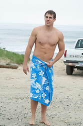 sexy man at the beach in a towel