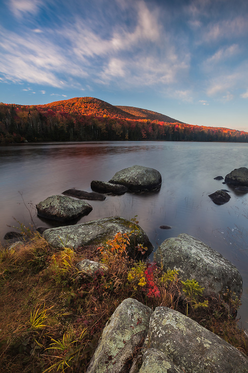 Streaking clouds and peak fall color on Seyon Pond, Groton State Forest, Vermont