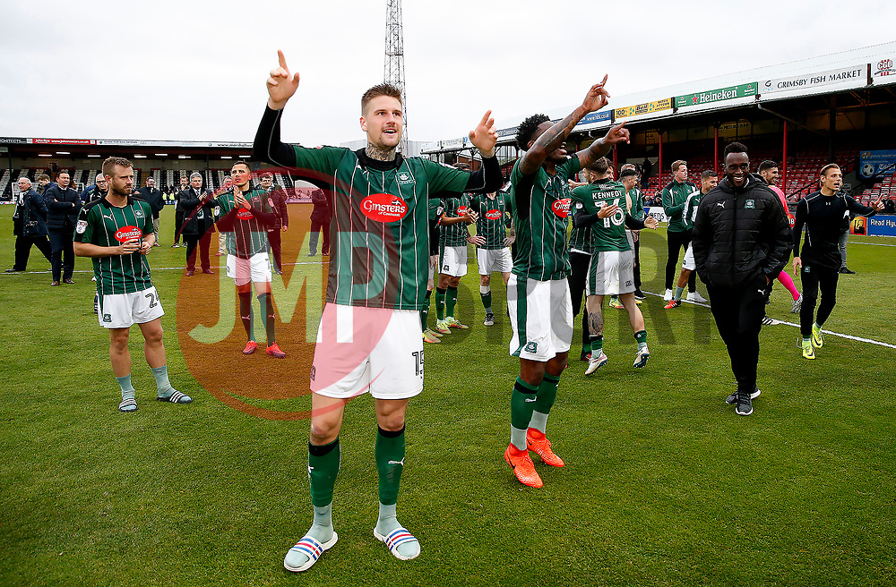 Sonny Bradley and Yann Songo'o of Plymouth Argyle celebrate after achieving promotion to SkyBet League One - Mandatory by-line: Matt McNulty/JMP - 06/05/2017 - FOOTBALL - Blundell Park - Cleethorpes, England - Grimsby Town v Plymouth Argyle - Sky Bet League Two