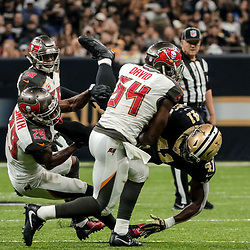 Nov 5, 2017; New Orleans, LA, USA; Tampa Bay Buccaneers linebacker Lavonte David (54) forces a fumble by New Orleans Saints running back Alvin Kamara (41) during the first half of a game at the Mercedes-Benz Superdome. Mandatory Credit: Derick E. Hingle-USA TODAY Sports