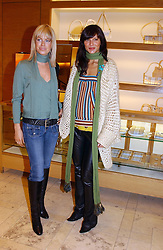 Left to right, CAROLINE HABIB and ULIA MUNSTERMANN at a party hosted by Burberry to launch their special collection in aid of Breakthrough Breast Cancer, held at 21-23 New Bond Street, London W1 on 5th October 2004.<br />
