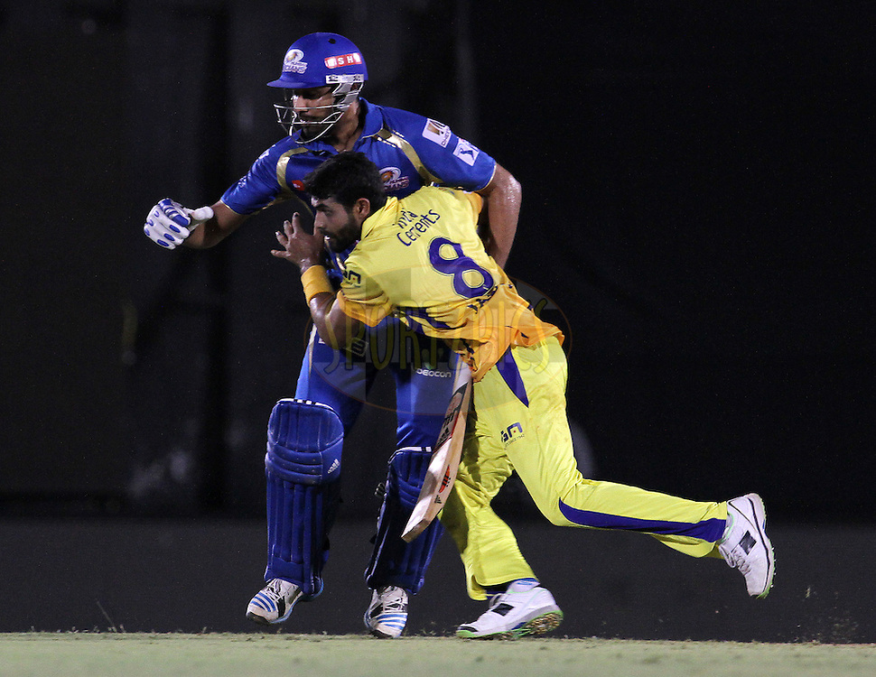 Ravindra Jadeja of The Chennai Superkings collides with Rohit Sharma captain of the Mumbai Indians during the eliminator match of the Pepsi Indian Premier League Season 2014 between the Chennai Superkings and the Mumbai Indians held at the Brabourne Stadium, Mumbai, India on the 28th May  2014<br /> <br /> Photo by Vipin Pawar / IPL / SPORTZPICS<br /> <br /> <br /> <br /> Image use subject to terms and conditions which can be found here:  http://sportzpics.photoshelter.com/gallery/Pepsi-IPL-Image-terms-and-conditions/G00004VW1IVJ.gB0/C0000TScjhBM6ikg