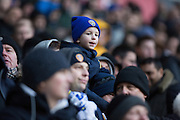 A young Leeds United fan watches on during the The FA Cup fourth round match between Bolton Wanderers and Leeds United at the Macron Stadium, Bolton, England on 30 January 2016. Photo by Simon Brady.