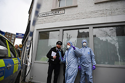 © Licensed to London News Pictures. 08/03/2019. Fulham, London, UK. Police officers at Lanfrey Place where 17yr old Ayub Hassan died of stab wounds sustained in an attack yesterday afternoon. Four teenagers have been arrested in connection with the murder, the investigation continues. Photo credit: Guilhem Baker/LNP