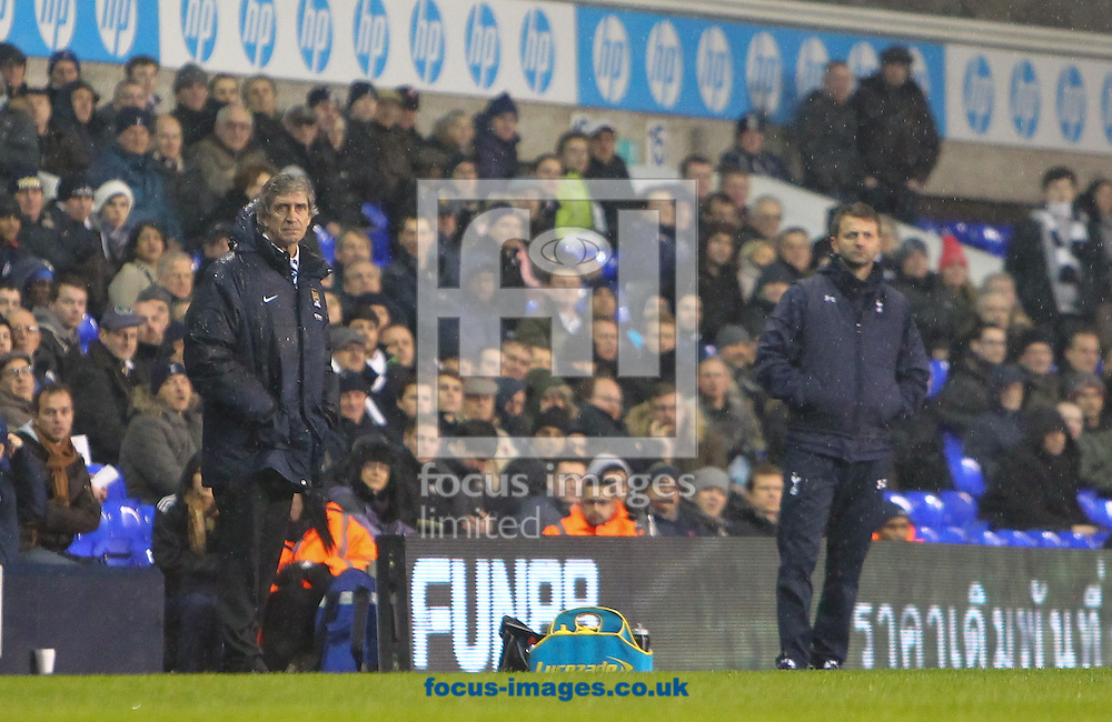Picture by John Rainford/Focus Images Ltd +44 7506 538356<br /> 29/01/2014<br /> Managers Tim Sherwood of Tottenham Hotspur and Manuel Pellegrini of Manchester City look on through the rain during the Barclays Premier League match at White Hart Lane, London.