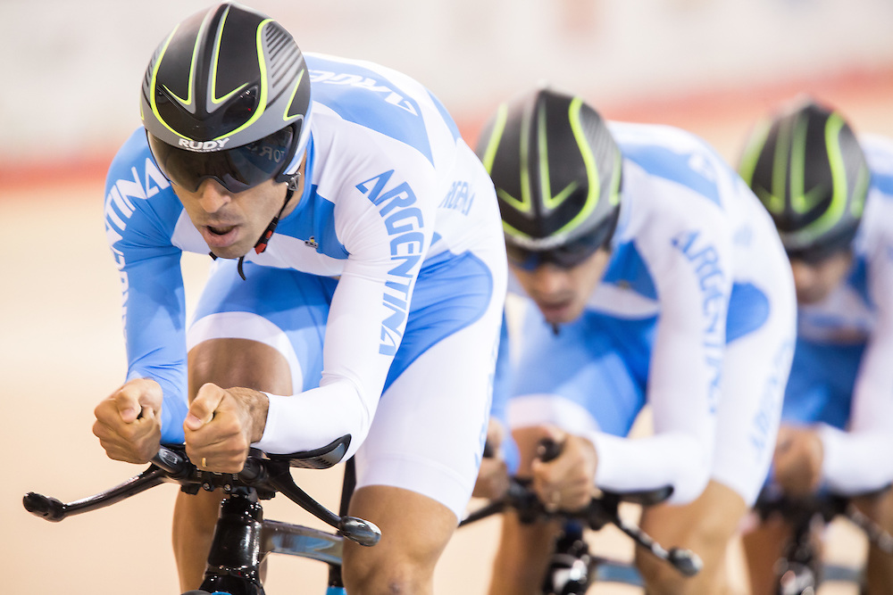 The Argentinean team of Walter Perez, Maximiliano Richeze, Adrian Richeze and Mauro Agostini race in the 1st round of the men's cycling team pursuit  at the 2015 Pan American Games in Toronto, Canada, July 18,  2015.  AFP PHOTO/GEOFF ROBINS