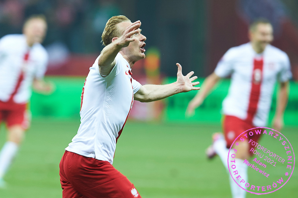 Poland's Sebastian Mila celebrates after scoring during the EURO 2016 qualifying match between Poland and Germany on October 11, 2014 at the National stadium in Warsaw, Poland<br /> <br /> Picture also available in RAW (NEF) or TIFF format on special request.<br /> <br /> For editorial use only. Any commercial or promotional use requires permission.<br /> <br /> Mandatory credit:<br /> Photo by &copy; Adam Nurkiewicz / Mediasport
